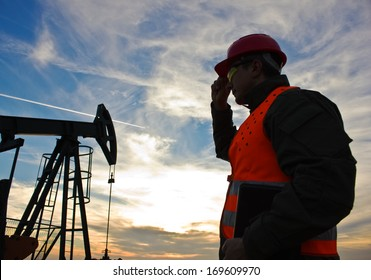 worker in the oil field industry at dusk,image soft focus,  best focus on the worker