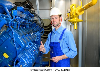 worker on big generator with thumb up