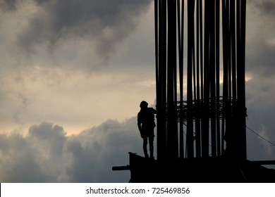 Worker on construction site in the morning silhouette