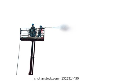 Worker on high, the man washing and cleaning on sherry picker by water jet isolated on white background.