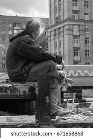 Worker on smoke break in Moscow Russia