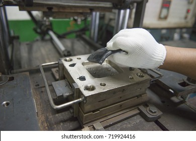 worker operating rubber compression machine