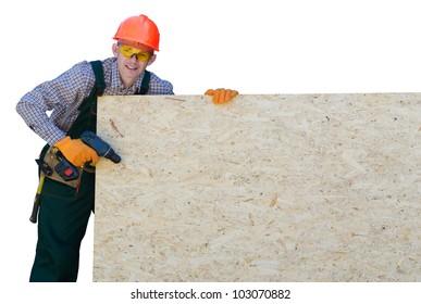 Worker in orange helmet posing near OSB plate