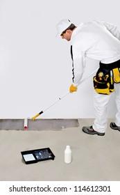 worker paint with primer concrete floor for waterproofing