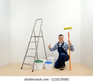 worker - painter with tool in the white room