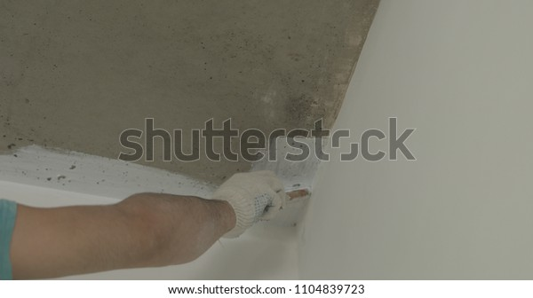 Worker Painting Concrete Ceiling Into White Stock Photo Edit Now 1104839723