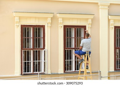 Worker painting  the window , outdoor