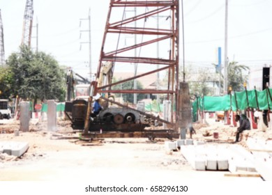 worker with pile  crane is working in construction site ,in blur