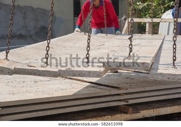 Worker placing cement floor in construction site