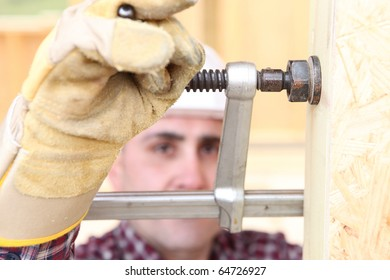 Worker with pliers