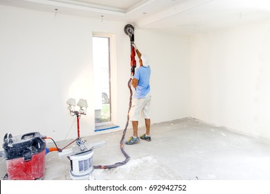 Worker polishes the wall