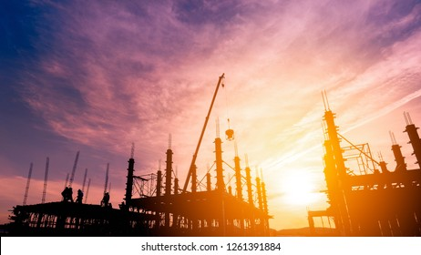 worker pouring concrete on high ground over blurred background sunset pastel