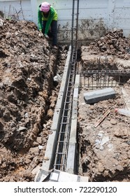 worker pouring concrete of steel bar reinforcement concrete for foundation work