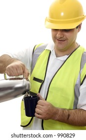 Worker pours water from a flask into a mug