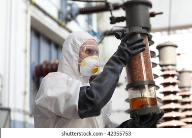 worker at a power plant inspecting output.