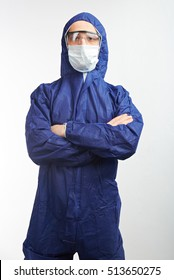 Worker in protective blue equipment and goggles isolated on white background