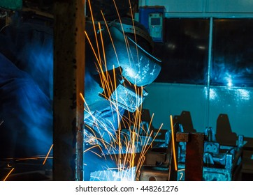 Worker with protective mask welding metal, knowledge to take action Gas welding car industry