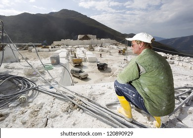 Worker in quarry of white marble