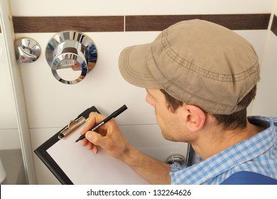 Worker reading tap water meter