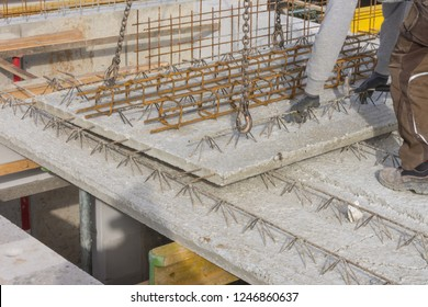 Worker relocates concrete slabs prefabricated parts