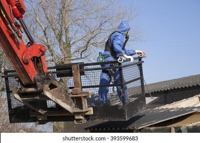 Worker removing asbestos