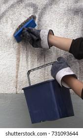Worker removing graffiti