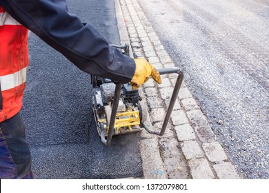 worker renovating a sidewalk