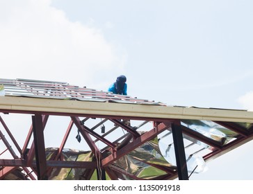 Worker repair roof house structure under construction with collapse by wind storm with old filter