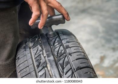 Worker  repair vehicle tire