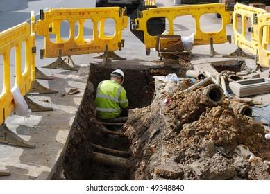 Worker repairing water pipe