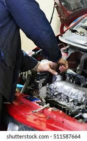 Worker repairs a car in a car repair center