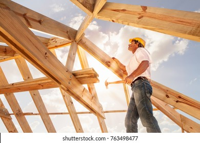 worker roofer builder working on roof structure on construction site