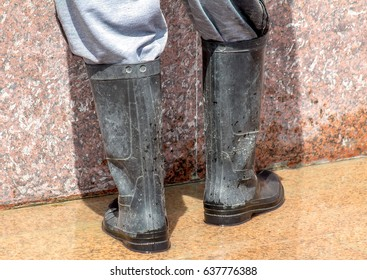 Worker in rubber boots