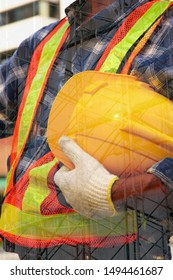 worker in safety suit holding yellow helmet with  steel scaffolding background. engineer wear uniform according to regulations  before working in construction site.safety first concept