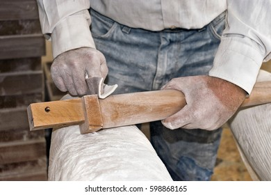 Worker sanding a piece of wood by hand. Skilled hands