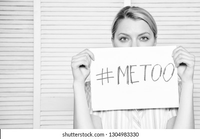 Worker share assault story. Me too social movement. Discrimination complaint. Female assault statistics. Woman calm face hold poster inscription hashtag me too. Victim assault harassment at workplace.