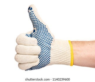 Worker showing gesture - giving the thumbs up sign. Male hand wearing working cotton glove with blue rubber dots, isolated on white background.