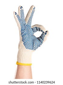 Worker showing gesture - ok sign. Male hand wearing working cotton glove with blue rubber dots, isolated on white background.