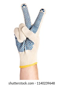 Worker showing gesture - two fingers, victory sign. Male hand wearing working cotton glove with blue rubber dots, isolated on white background.