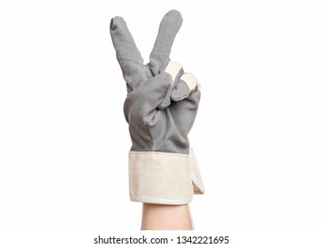 Worker showing gesture - two fingers, victory sign. Male hand wearing working glove with, isolated on white background.