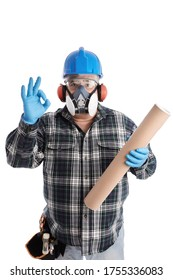 Worker showing ok sign and holding a carton tube. Worker equipted with protection helmet, earmuffs headphones, safety glasses, biosafety mask protection and gloves. Picture isolated on white.