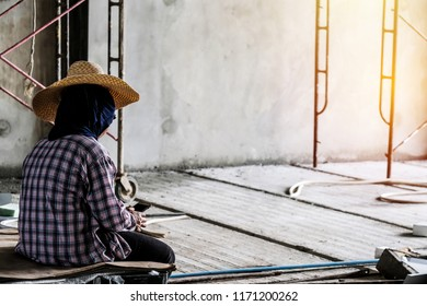 Worker sitting on chair and use smartphone during break time.