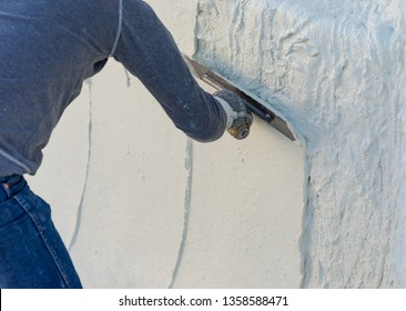 Worker Smoothing Wet Pool Plaster With Trowel.