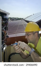 Worker and Solar panels on a house roof