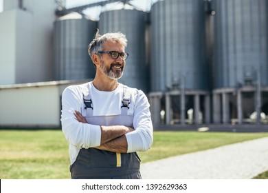 worker standing in front of grain silo