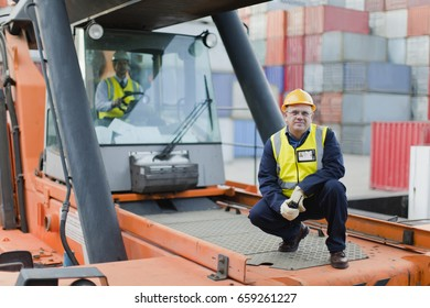 Worker standing on machinery on site