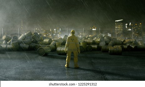 Worker stands in front of barrels of nuclear waste