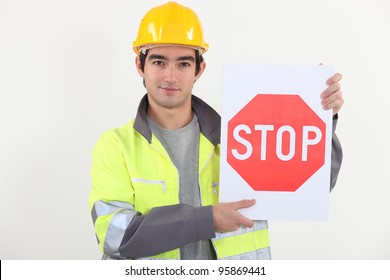 Worker with stop sign