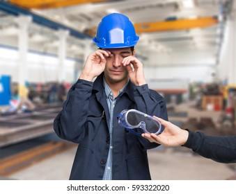 Worker suffering for a splinter in his eye