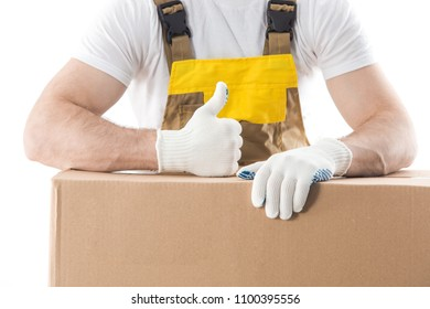 Worker with thumb up standing behind boxes with items isolated on white background. Good delivery background.